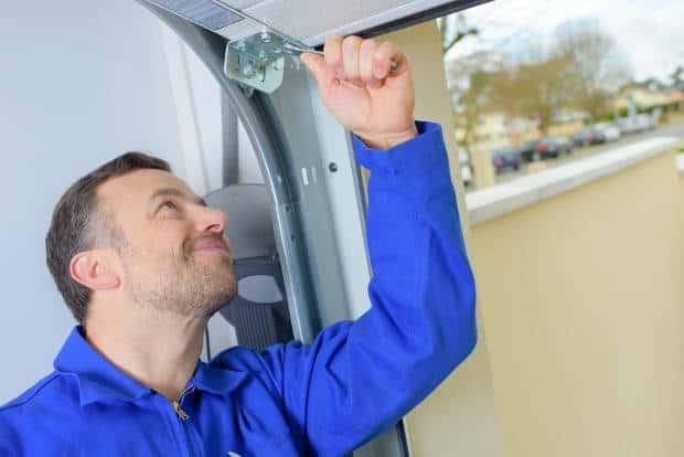 garage-door-technician-installing-a-new-door